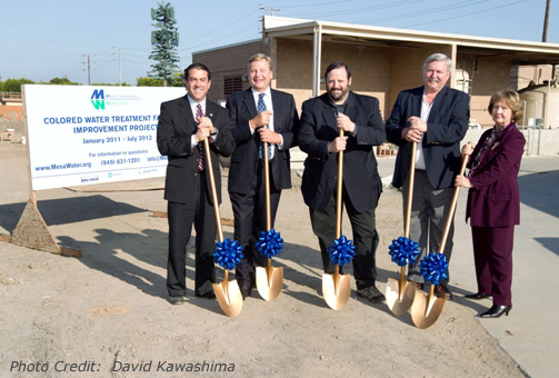 Clueless directors accidentally use shovels to point to exact location of new water treatment facility. Photo from Mesa Water website.